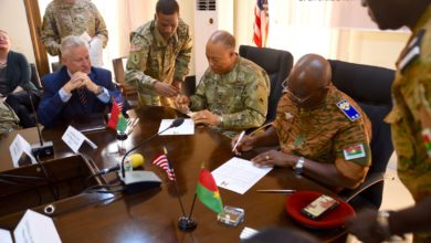 Maj. Gen. William J. Walker, Commanding General, District of Columbia National Guard and Brig. Gen. Moses Miningou the Chief of General Staff for the National Armed Forces of Burkina Faso, participate in a formal signing ceremony