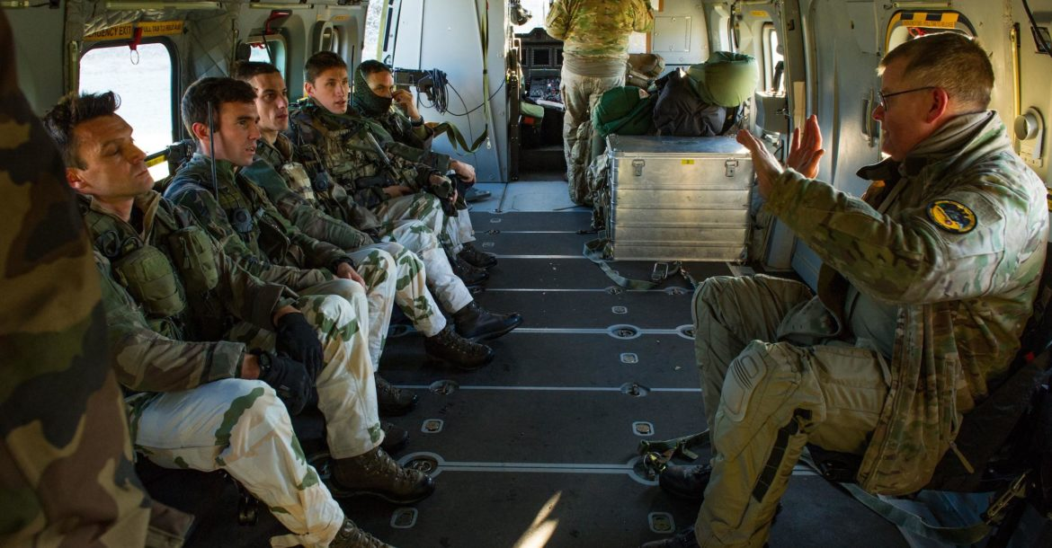 A Danish pilot gives a security brief to French Army troops