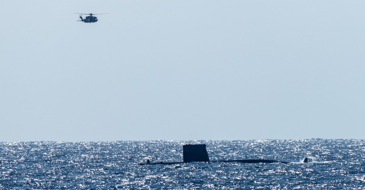 IONIAN SEA, Feb 25, 2018. HMCS Toronto helicopter flies over ESPS Tramonrana in Dynamic Manta 2019