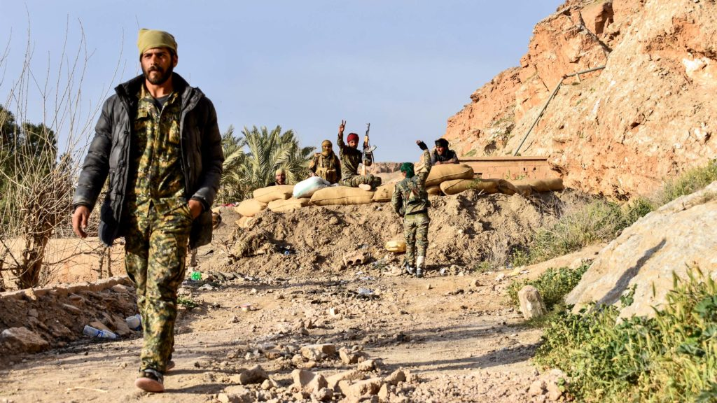 SDF fighters in Baghuz, Syria