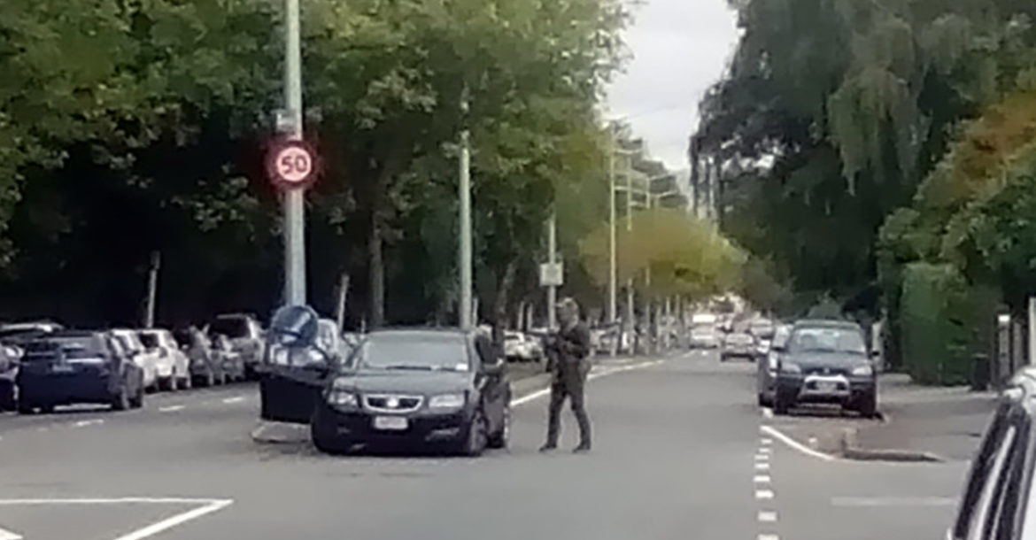 New Zealand police cordon a street near the mosque after a shooting in Christchurch