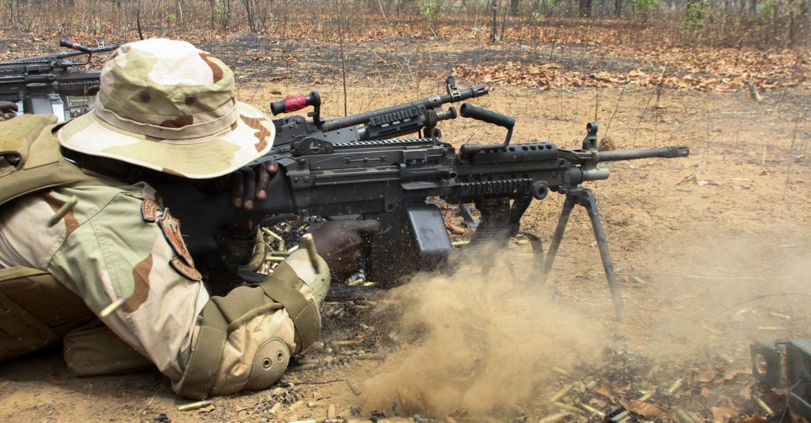 Senegal special forces soldier fires an M249 machine gun