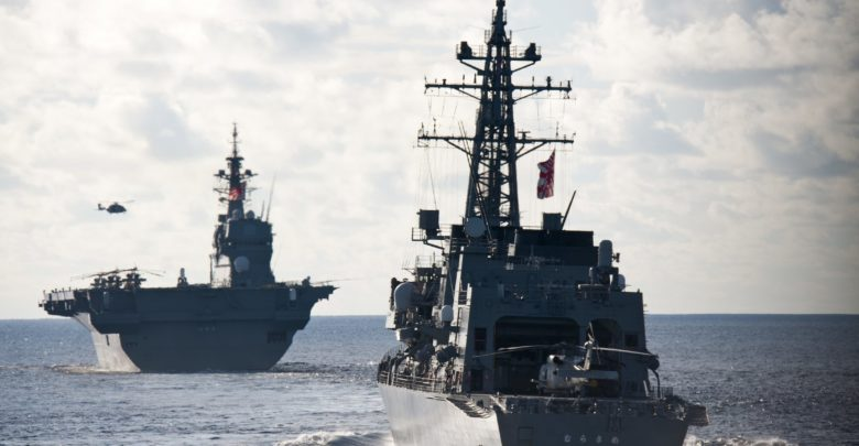 The Japan Maritime Self Defense Force Izumo-class helicopter destroyer JS Izumo and the Murasame-class destroyer JS Murasame
