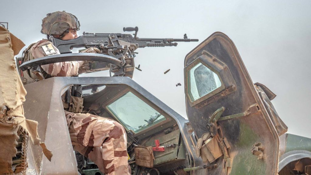 French soldier fires during Operation Aconit