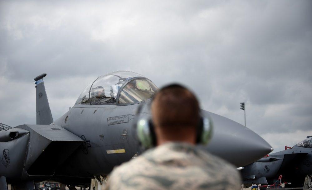 Qatari defense official prepares to fly WSO in F-15E