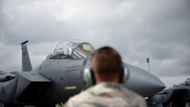 Qatari defense official prepares to fly WSO in F-15E