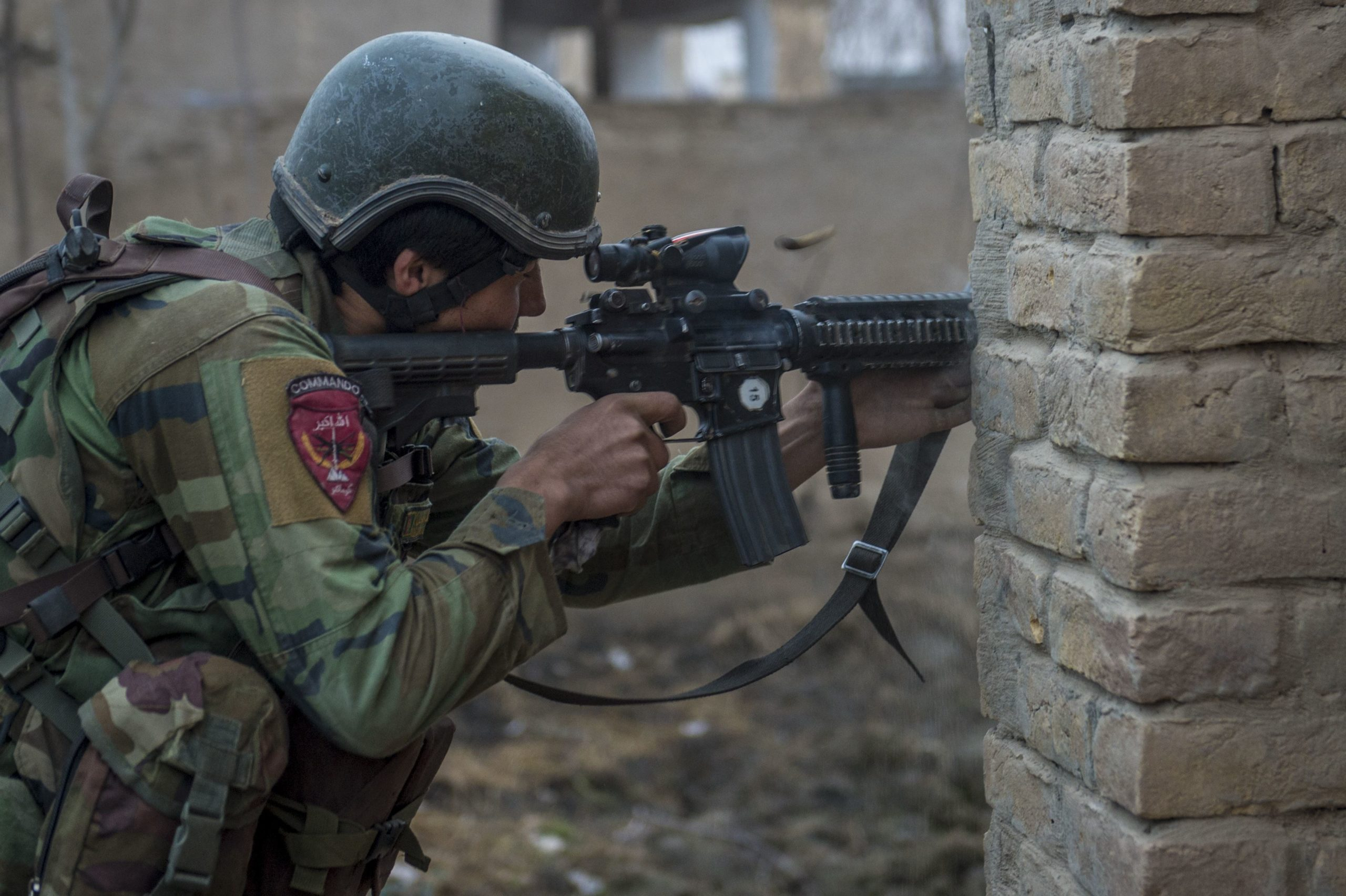An Afghan national Army 10th Special Operations Kandak Commando returns fire during offensive operations against the Taliban in Kunduz province, Afghanistan, January 20, 2018.
