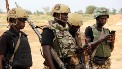 Nigerian army soldiers stand at a base