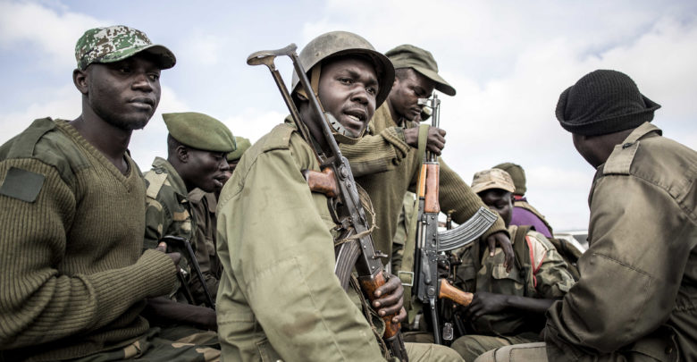 Soldiers of the Armed Forces of the Democratic Republic of the Congo (FARDC) prepare to escort health workers attached to ebola response programs on May 18, 2019 in Butembo, north of Kivu