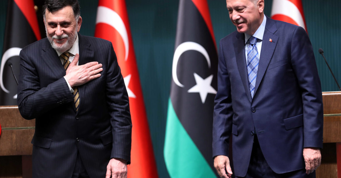 Turkish President Recep Tayyip Erdogan (R) and Libyan Prime Minister Fayez al-Sarraj hold a joint press conference at the Presidential Complex in Ankara on June 4, 2020.