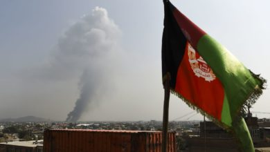 Smoke rises from the site of an attack after a massive explosion the night before near the Green Village in Kabul, September 2019.