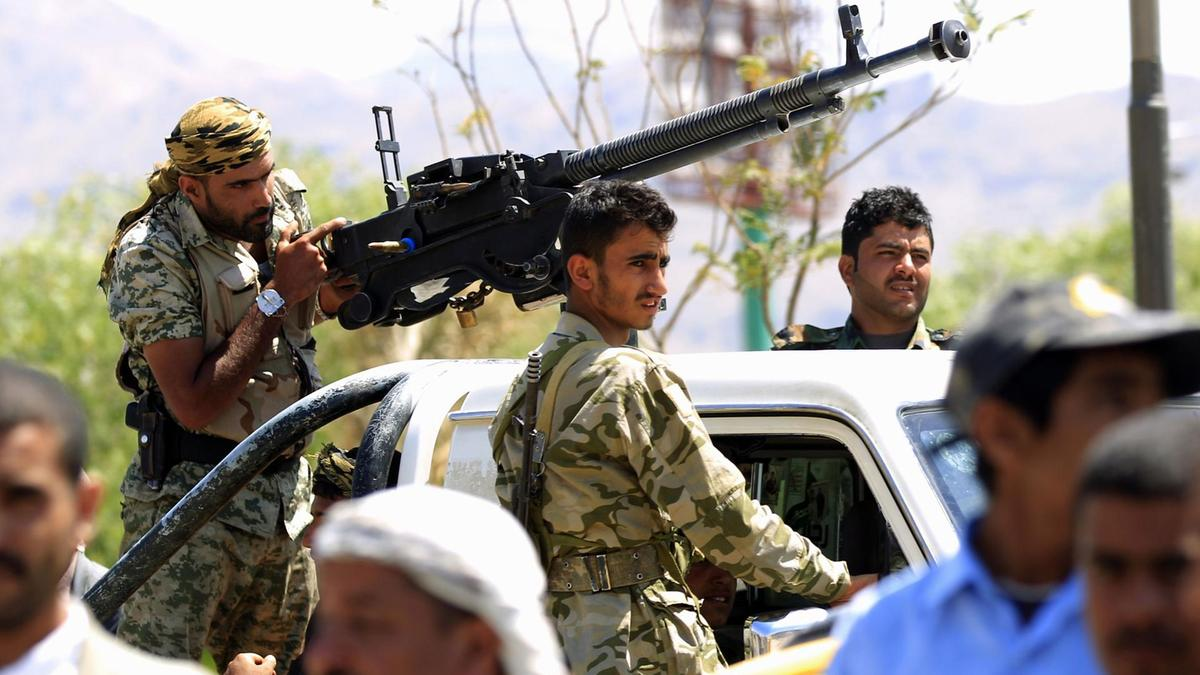 Houthi fighters guard a pro-rebel gathering in Sanaa on September 27, 2018