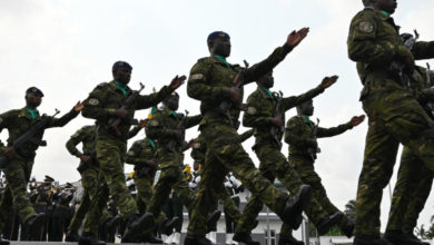 Ivory Coast army officers march during the funeral of Colonel Issiaka Ouattara,