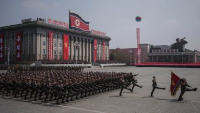 Korean People's Army (KPA) soldiers watch a military parade marking the 105th anniversary of the birth of late North Korean leader Kim Il-Sung, in Pyongyang on April 15, 2017.
