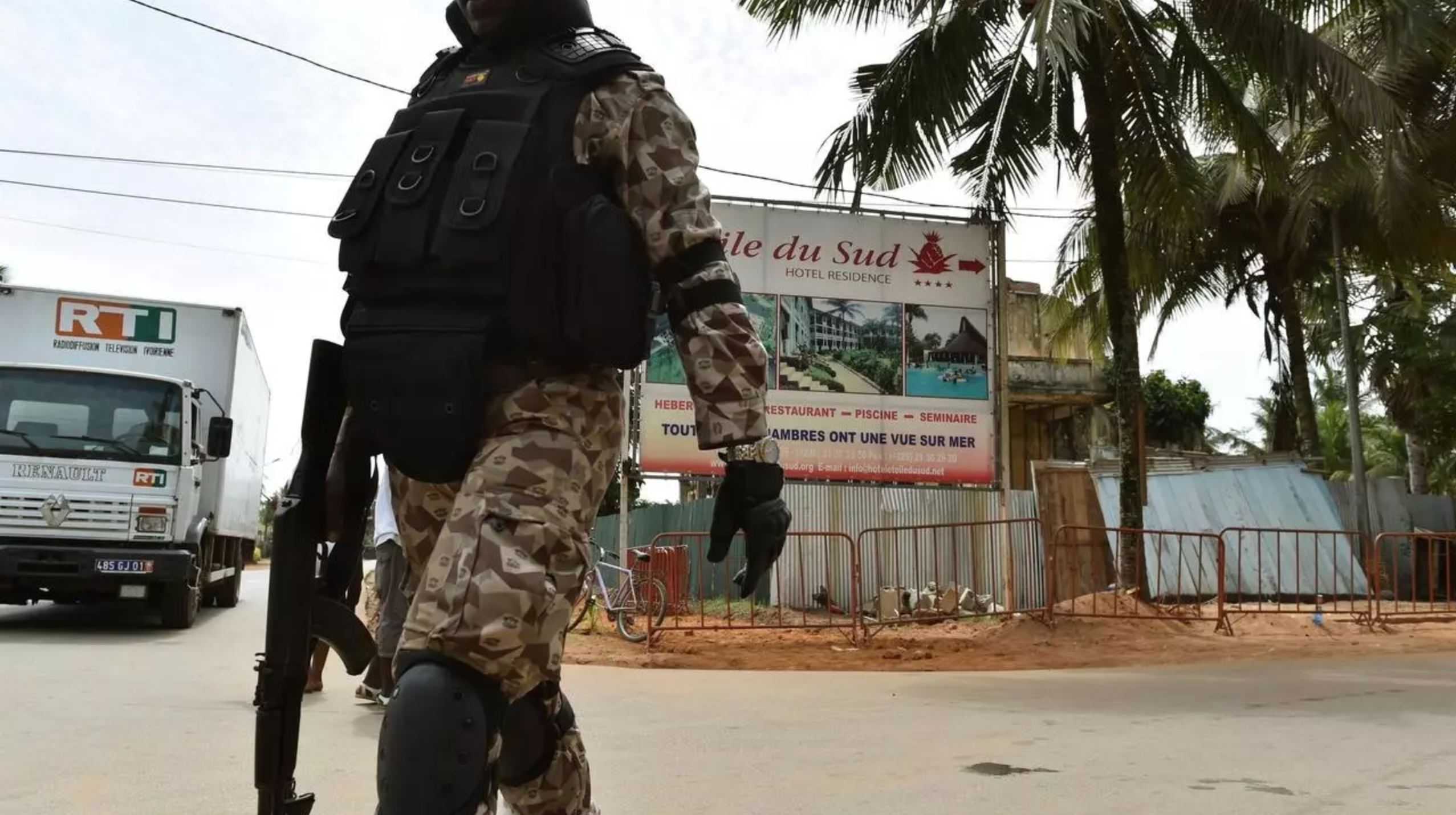 A soldier patrols near the hotel Etoile du Sud in Grand Bassam, Ivory Coast, on March 13, 2016 during a commemoration ceremony for the first anniversary of the 2016 Grand Bassam beach terrorist attack, resulting in the death of 19 people.