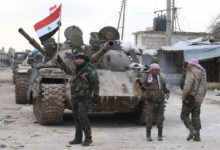 Syrian government forces deploy near the Damascus-Aleppo highway in the southern part of Syria's northern Aleppo province on February 10, 2020