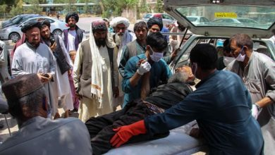 Elderly civilian injured in Sangin marketplace explosions.