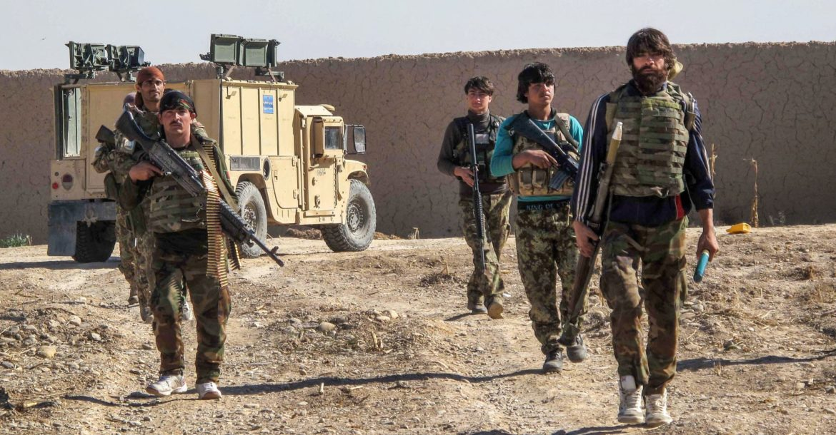 Afghan soldiers patrolling an area in Helmand Province.