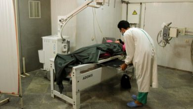 An injured woman is treated at a hospital after an air strike west of Kabul, Afghanistan on July 23, 2020.