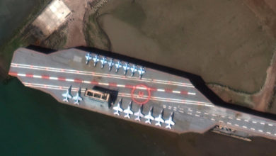 Satellite image obtained courtesy of Maxar Technologies shows a mockup aircraft carrier being prepared in the Iranian port of Bandar Abbas on February 15. Maxar Technologies/AFP