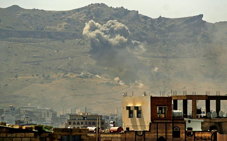 Smoke billows following a reported airstrike by the Saudi-led coalition in the Yemeni capital Sanaa, on July 1, 2020