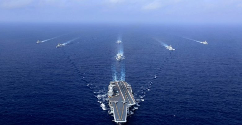 China's Liaoning aircraft carrier (C) sailing during a drill in the South China Sea, April 18, 2018. Photo: AFP/Getty Images