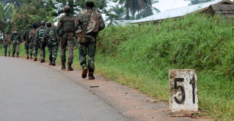 Democratic Republic of Congo soldiers march on December 31, 2013 in Eringeti towards the front line in Beni to fight against the Allied Democratic Forces.