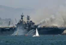 A fire burns on the amphibious assault ship USS Bonhomme Richard at Naval Base San Diego on July 12, 2020 in San Diego, California. There was an explosion on board the ship with multiple injuries reported