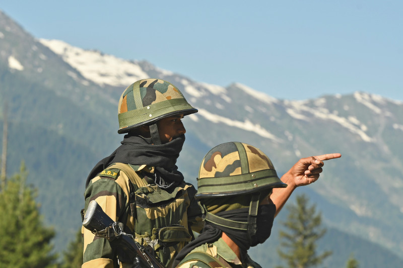 Indian Border Security Force (BSF) soldiers guard a highway leading towards Leh, bordering China, in Gagangir on June 17, 2020.