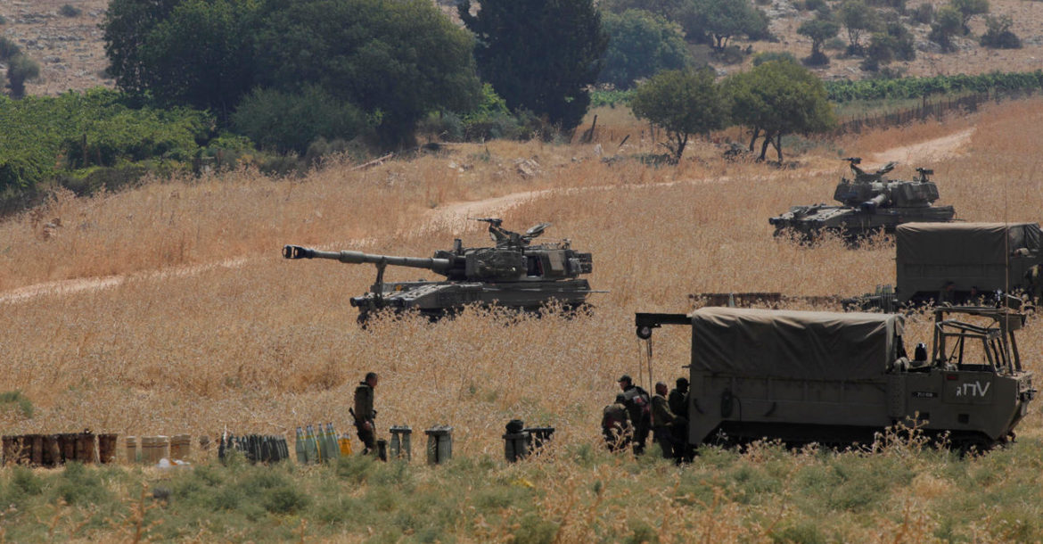 Armoured vehicles and 155 mm self-propelled howitzers deployed in the Upper Galilee in northern Israel on the border with Lebanon on July 27, 2020