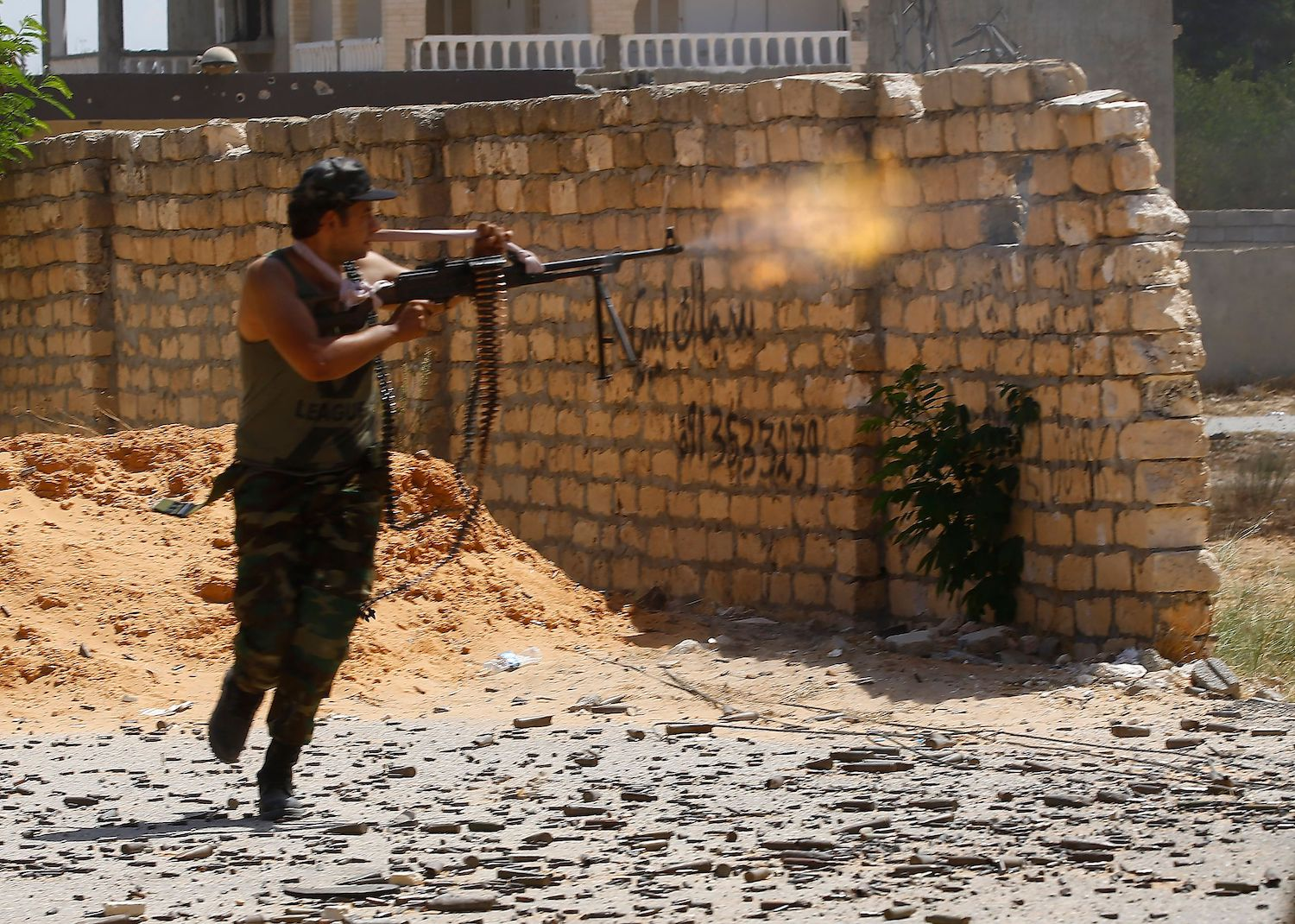 A fighter loyal to the UN-recognized Libyan Government of National Accord (GNA) clashes with forces loyal to strongman Khalifa Haftar in the suburb of Ain Zara in Tripoli on September 7, 2019.