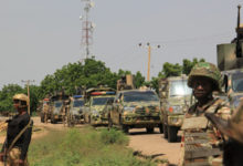 Nigerian soldiers patrol on October 12, 2019, after gunmen suspected of belonging to the Islamic State West Africa Province (ISWAP) group carried out a deadly attack in the village of Tungushe, Borno state