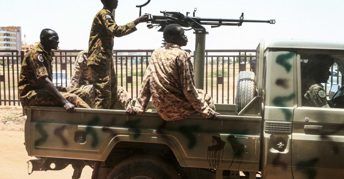 Sudanese soldiers seen in a convoy escorting Bashir back to prison after his appearance in court in Khartoum in August, 2019.