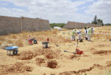 Libyan Ministry of Justice employees dig at the site of a suspected mass grave in Tarhouna, Libya on June 23, 2020.