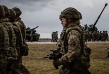 US troops marching in NATO welcome ceremony in Orzysz, Poland on April 13, 2017.