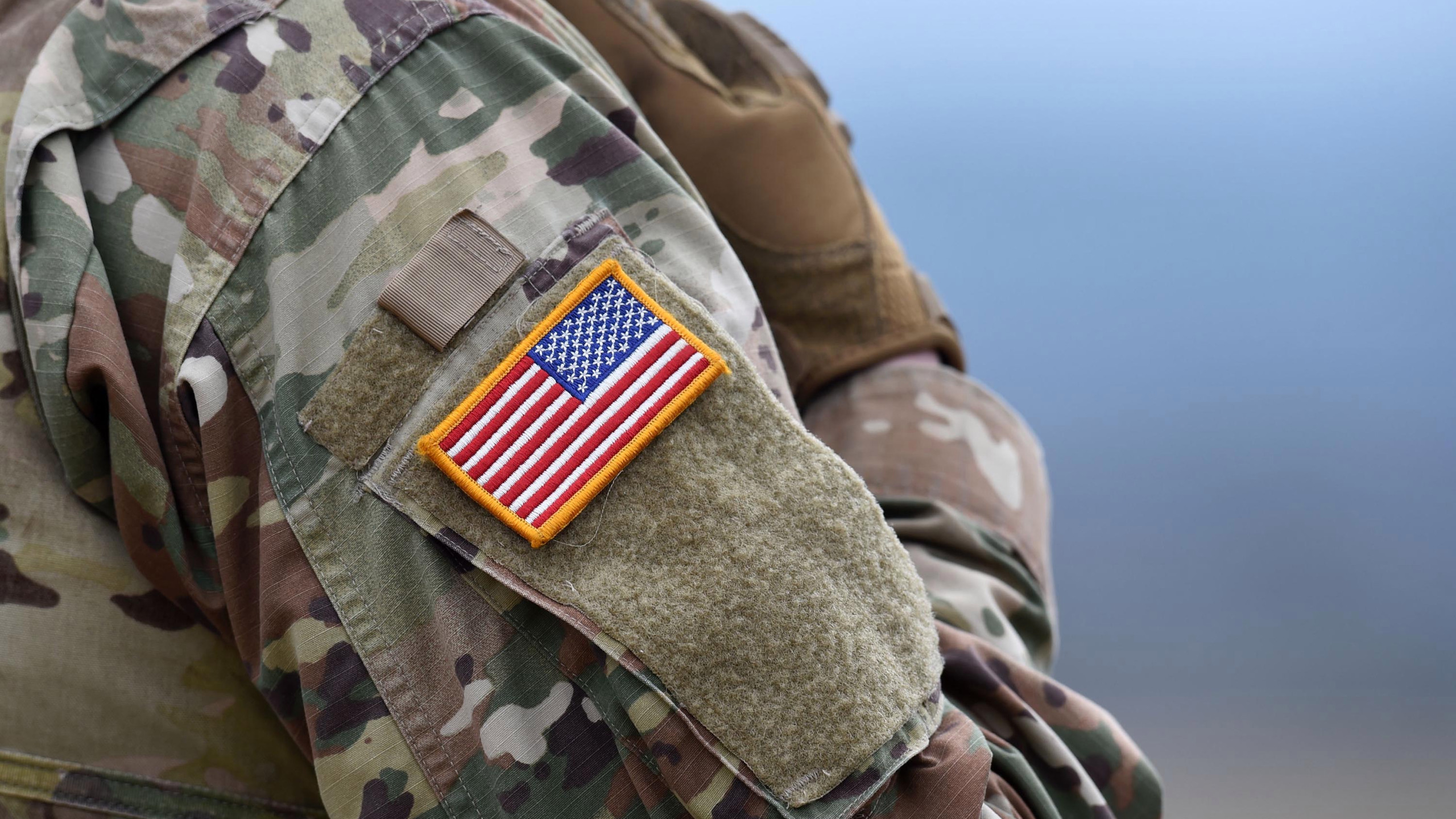 A US flag is pictured on a soldier's uniform during an artillery live fire event by the US Army Europe's 41st Field Artillery Brigade at the military training area in Grafenwoehr, southern Germany, on March 4, 2020.
