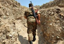 An Armenian soldier of the self-proclaimed republic of Nagorno-Karabagh walks in a trench at the frontline on the border with Azerbaijan near the town of Martakert.