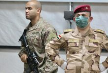 A US soldier, left, and an Iraqi army officer at Qayyarah air base in northern Iraq earlier this year