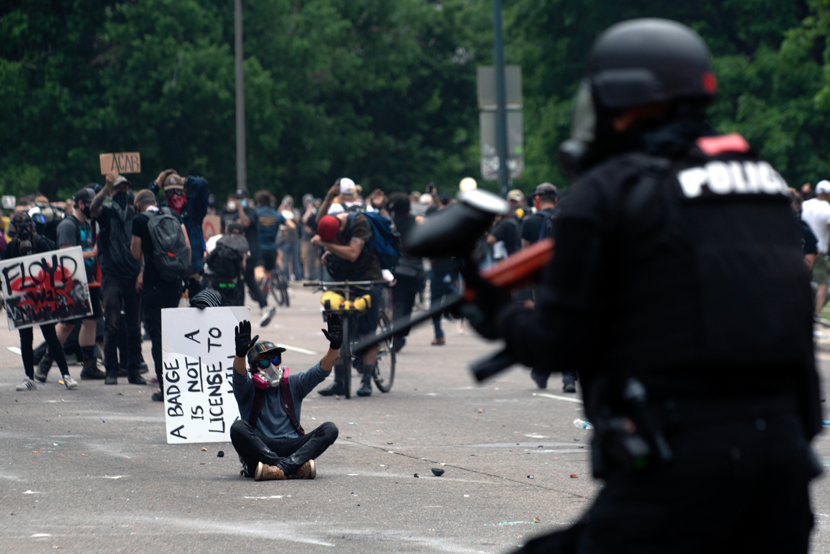 Protester and police
