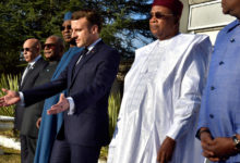 French President Emmanuel Macron (center) gestures during a joint news conference with his counterparts from five Sahel nations in Noukchott, Mauritania