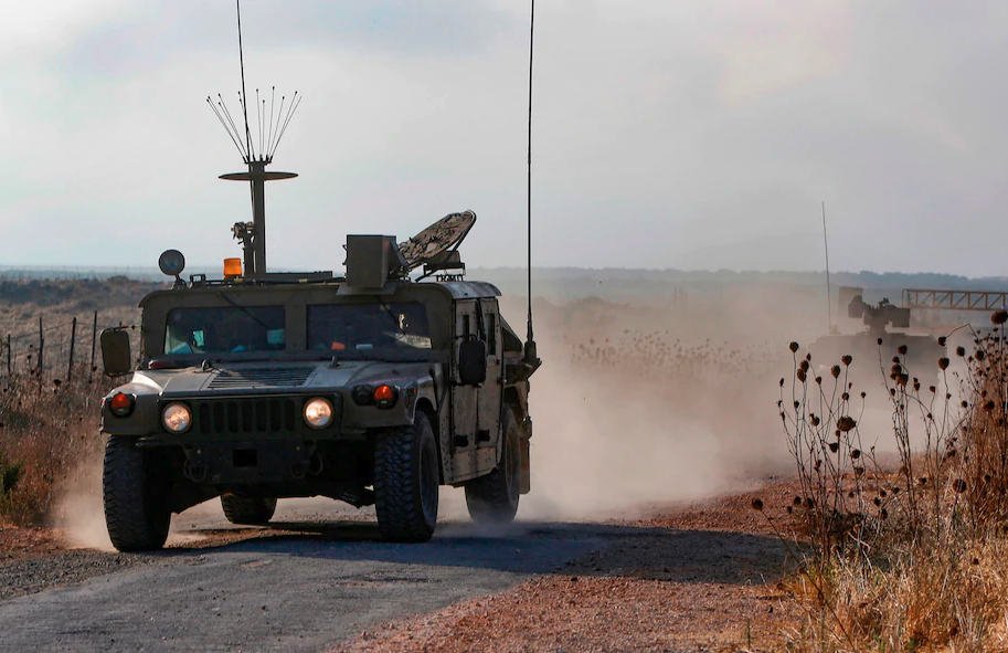An Israeli military vehicle patrols near the Syrian border in the Israeli-annexed Golan Heights on Aug. 3, near the location where the army said it killed four men placing explosives at a security fence.