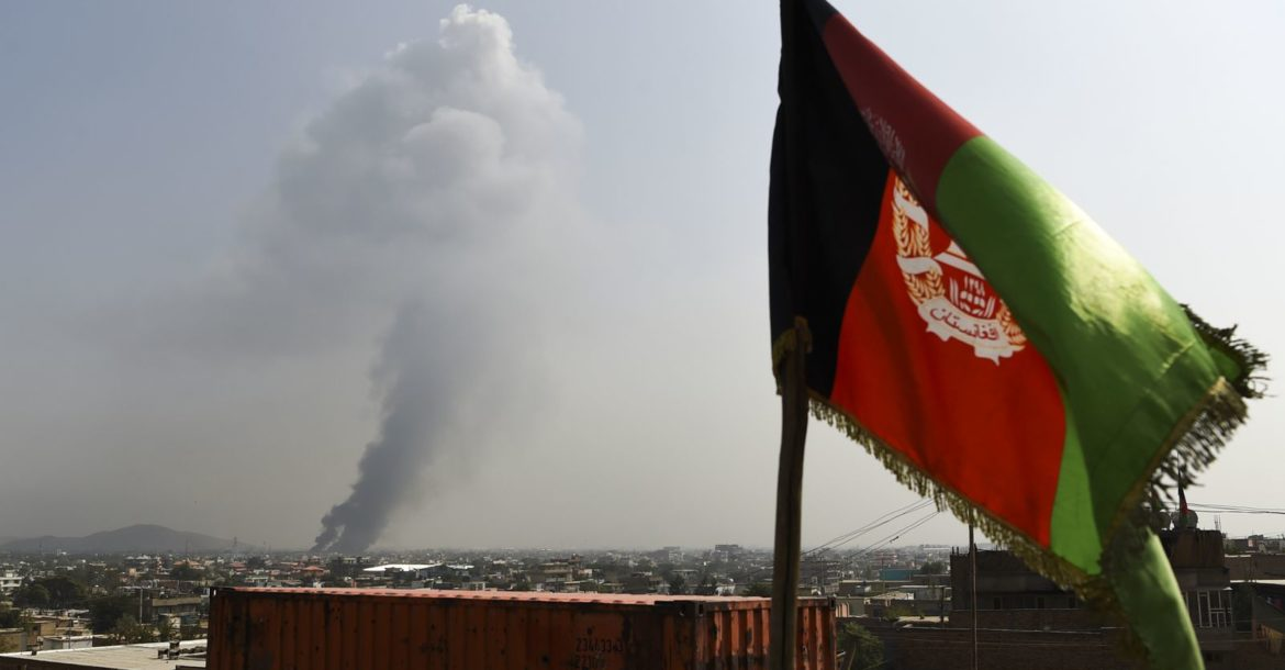 Smoke rises from the site of an attack after a massive explosion the night before near the Green Village in Kabul, September 2019
