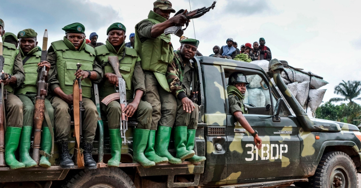 Armed soldiers of the DR Congo army on a vehicle.