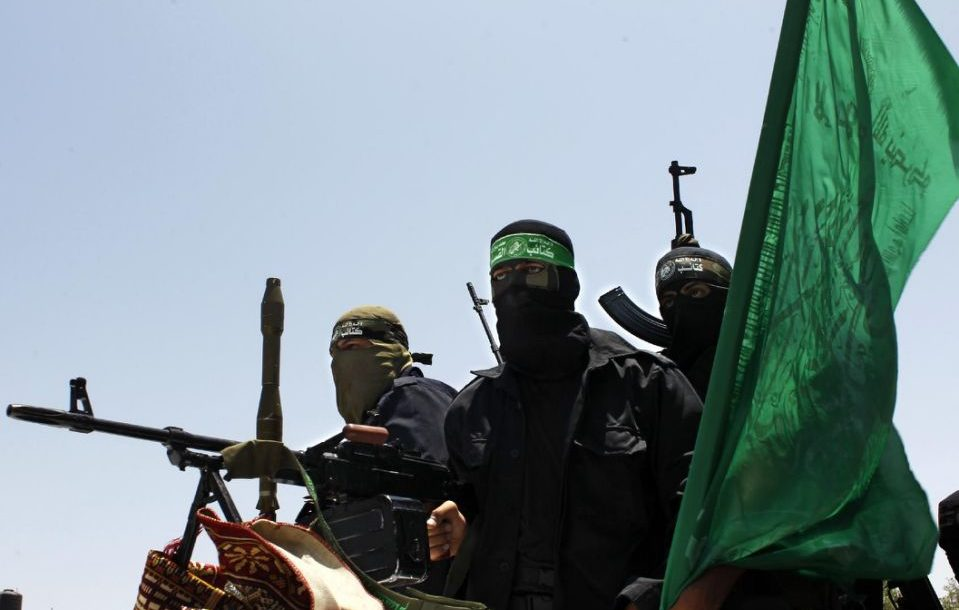 Hamas military personnel set atop military grade vehicles.