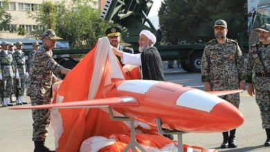 "Brigadier-General Alireza Sabahifard, center, unveils the ""Kian,"" a high-precision drone that can locate and attack targets far from the country's borders during a ceremony in the capital Tehran, September 2019."