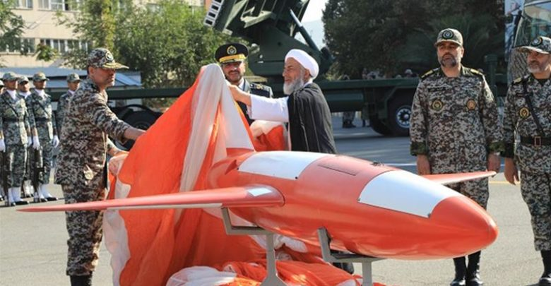"""Brigadier-General Alireza Sabahifard, center, unveils the """"Kian,"""" a high-precision drone that can locate and attack targets far from the country's borders during a ceremony in the capital Tehran, September 2019."""