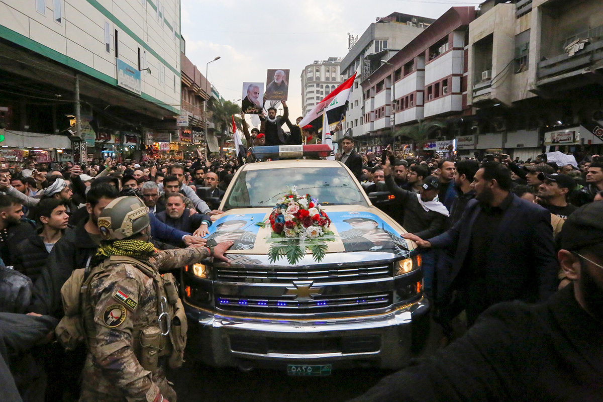 Mourners surround a car carrying the coffins of Iranian military commander Qasem Soleimani and Iraqi paramilitary chief Abu Mahdi al-Muhandis, killed in a US air strike, in Baghdad on January 4, 2020. Photo: Sabah Arar/AFP.