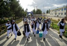 Taliban prisoners walk as they are in the process of being potentially released from Pul-e-Charkhi prison, on the outskirts of Kabul on July 31, 2020.