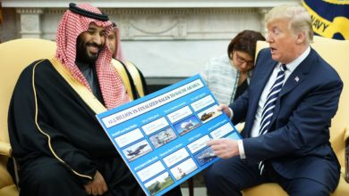 President Donald Trump shows a chart highlighting arms sales to Saudi Arabia during a meeting with Saudi Crown Prince Mohammed bin Salman in the Oval Office of the White House, Tuesday, March 20, 2018.