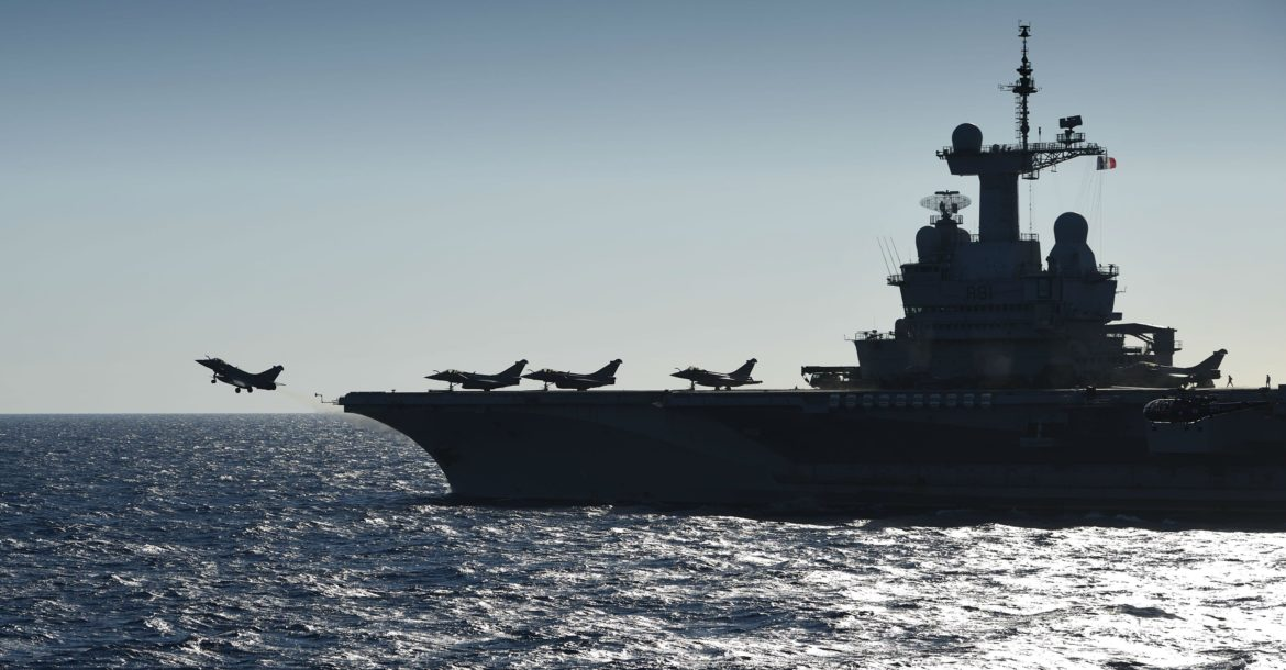 A rafale fighter jet takes off from the French aircraft carrier Charles de Gaulle sailing in the Mediterranean sea on September 29, 2016 in the Mediterranean sea as part of the Operation Arromanches III.